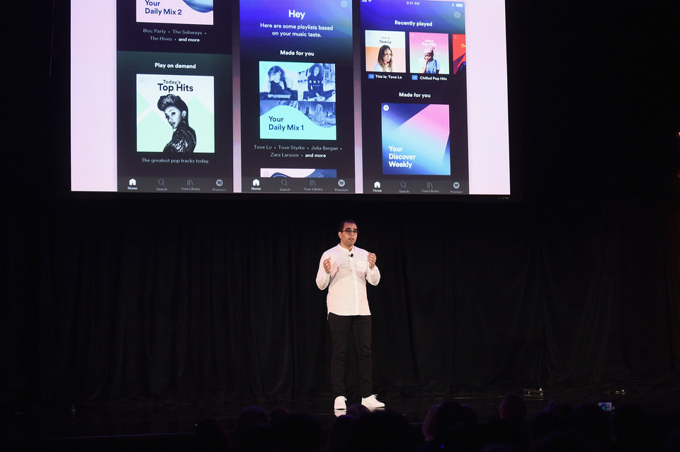 Spotify's Vice President of Growth Babar Zafar demos Spotify's new new ad-supported mobile version at a news conference in New York.JPG