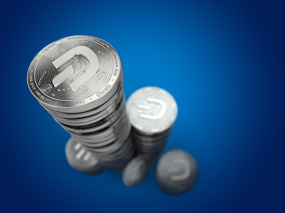 Dash Coins Tall Stack Blue Background.jpg