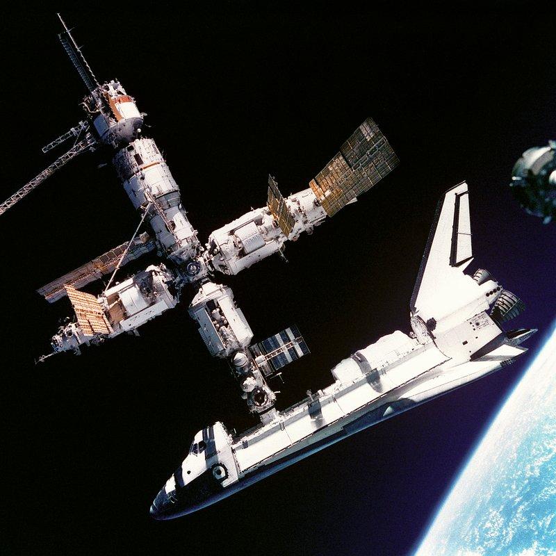 Shuttle Docked with Mir_NASA Photo_619926main_sts-71_docked.jpg