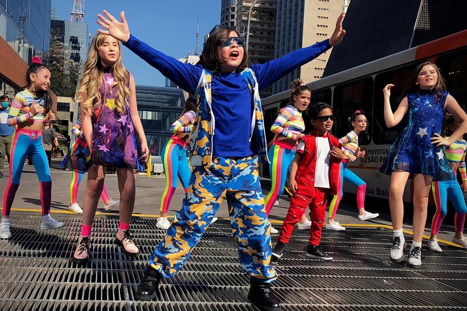 Kevin Keew, trio kids H2M and dancers recording Wake Up Samba music video in Sao Paulo city, Brazil