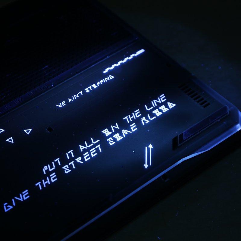Secret message in the laptop base under UV flashlight.JPG