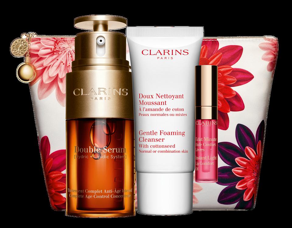 Clarins, Zestaw pielęgnacyjny: Double Serum (30 ml), Gentle Foaming Cleanser (15 ml), Instant Light Lip Comfort Oil w odcieniu 04 Candy, elegancka kosmetyczka