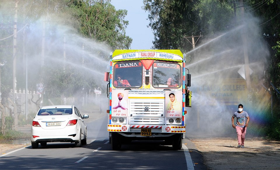 A municipal corporation vehicle sprays disinfectant  on 4 May, 2020 in Patiala, India. (Photo by Bharat Bhushan/Hindustan Times via Getty Images)