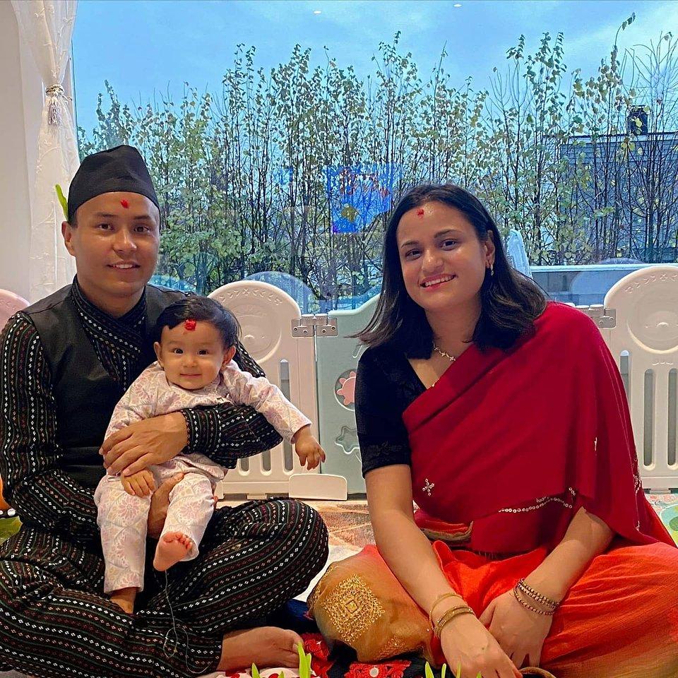 Santosh, Quree and little Luniva – the whole family celebrating Dashain festival in traditional Newari attire.