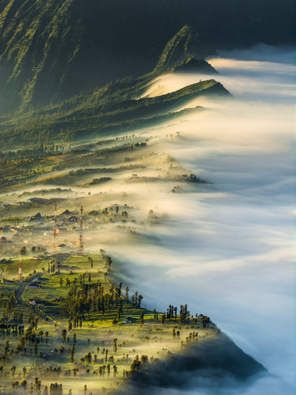 Mist disappears slowly as the sun rises on Mount Bromo, Indonesia (Tian Abdul Hanip/AGORA images)
