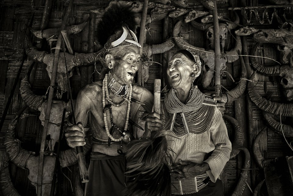 This photo portrays two members of one of India's oldest tribe: the Konyac tribe. The woman on the right (96 years old) was once the queen of the tribe and the man on the left (103 years old) used to be her bodyguard. This couple are the last members of this age group in the Konyac community.
