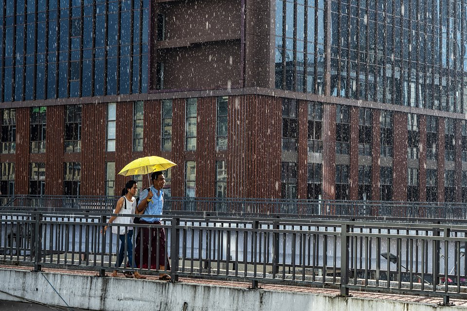 Love is all about looking at the same direction, rain or shine (Myo Thet/AGORA images)