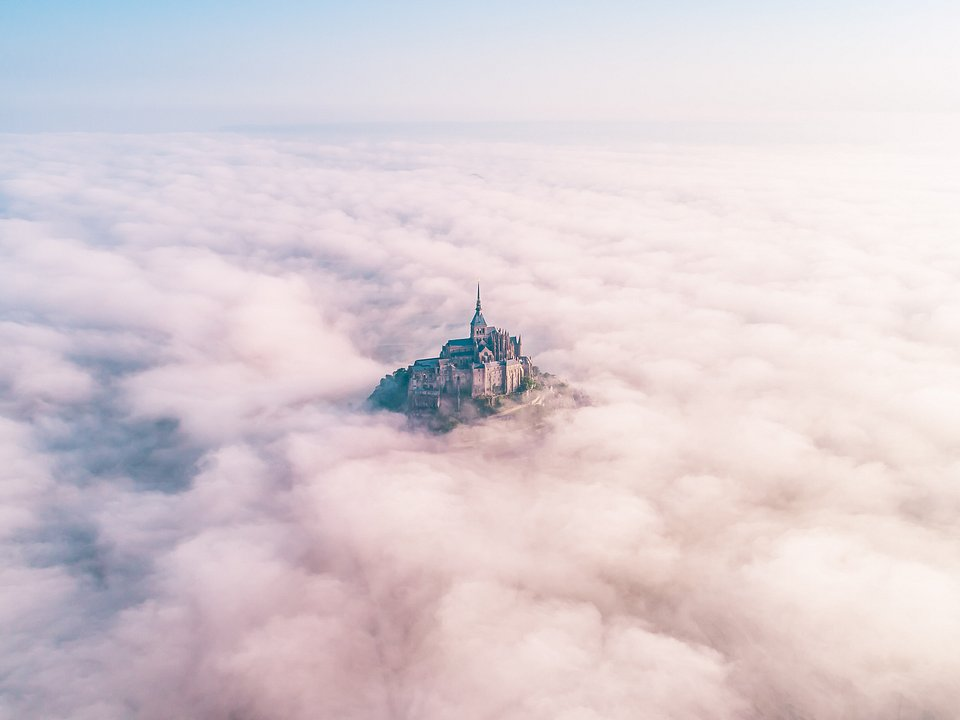 The Mont Saint Michel, France, lost in the middle of the fog (Konrad Paruch/Agora)