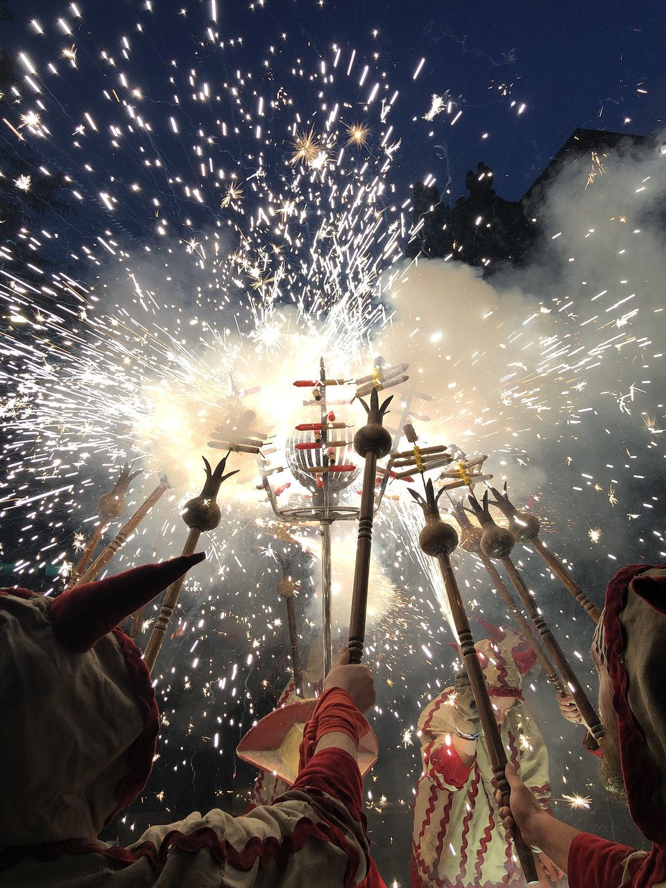 Correfocs during traditional Catalan festival, where groups dressed as devils light firework in the crowd (Albert Castañe/Agora)