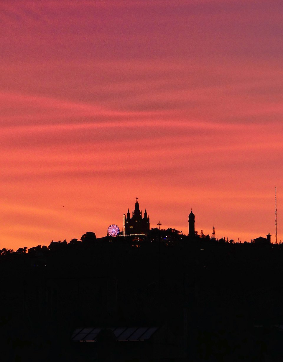 Sunset over Tibidabo, Barcelona's highest mountain and home of the Sagrat Cor church and one of the oldest amusement park in the world that was built in 1899 (Albert Castañe/AGORA images)