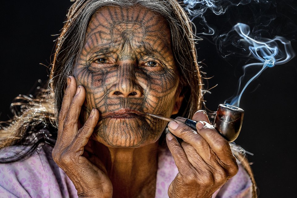 Traditional face tattoo from the Chin tribe, settling near the Bangladesh/Myanmar border. In an attempt to protect their daughters from being stolen by neighboring tribes, parents would tattoo their young child's face to intend to make them undesirable for other tribes. This practice is no longer permitted by the Burmese authorities. (Ye Pyae Soe Hlaing/AGORA images)