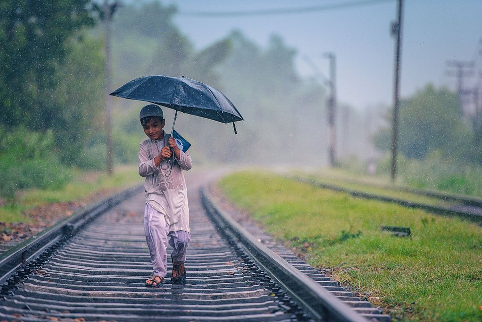 A child's purity is captured here, when this boy was spotted roaming in the rain. His sparkling face and joyful gesture is what drew Chisti to take his picture. (Adeel Chishti/Agora)