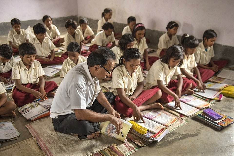 A teacher goes out of his way to take initiative in his students' learning, even when the infrastructural support of the classroom and education system is at a bare minimum. (Amitava Chandra/Agora)