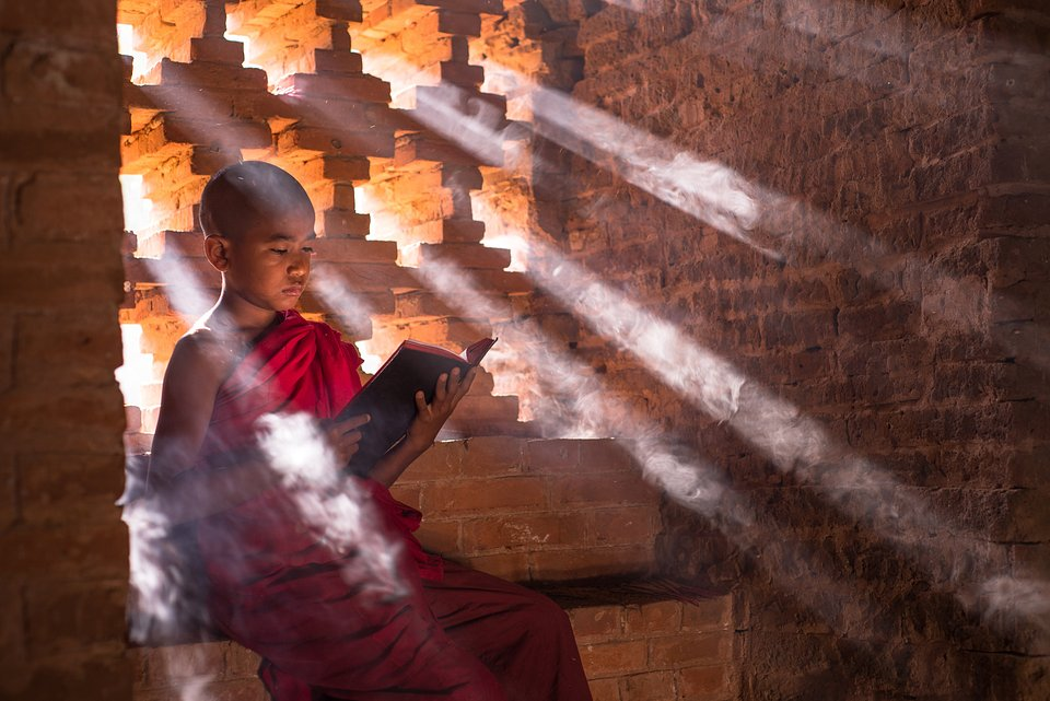 As the temperatures rise in Bagan, some monks come under the shade of the temples to study, read, relax, and pray. (Saw Fabian/Agora)