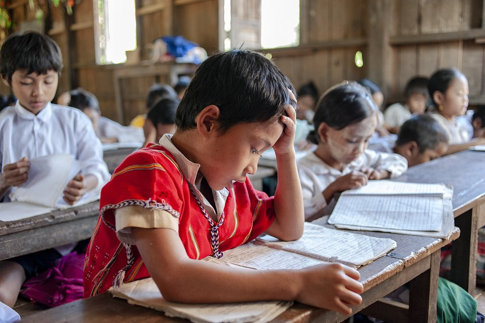 This boy is studying hard in his classroom in Kayin, Myanmar. (Swe Tun/Agora)