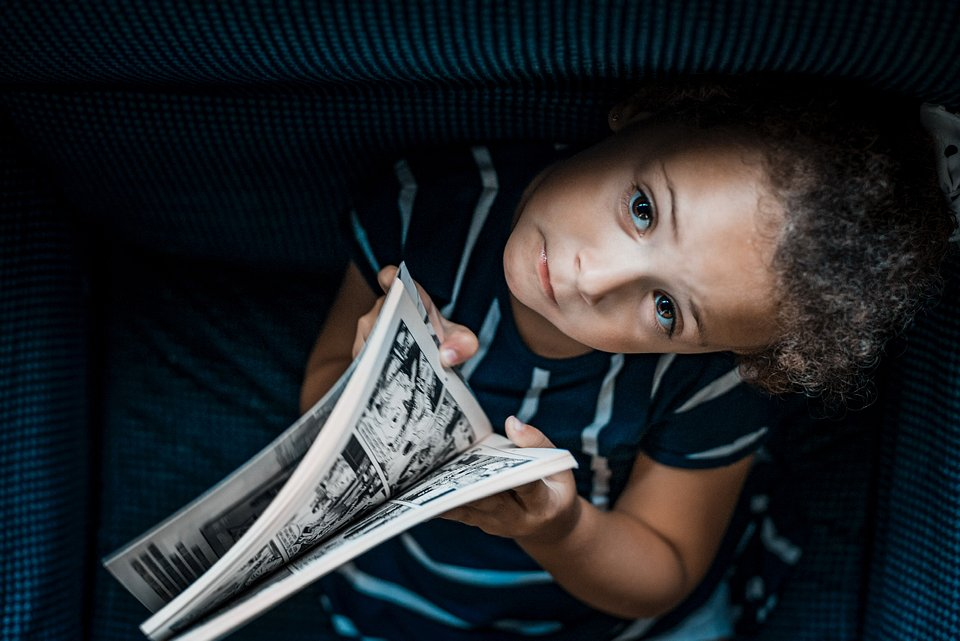 A child enjoying a comic book on a gloomy day in Santa Cruz de Tenerife, Spain. (Wilmer Valdez Hinojosa/Agora)