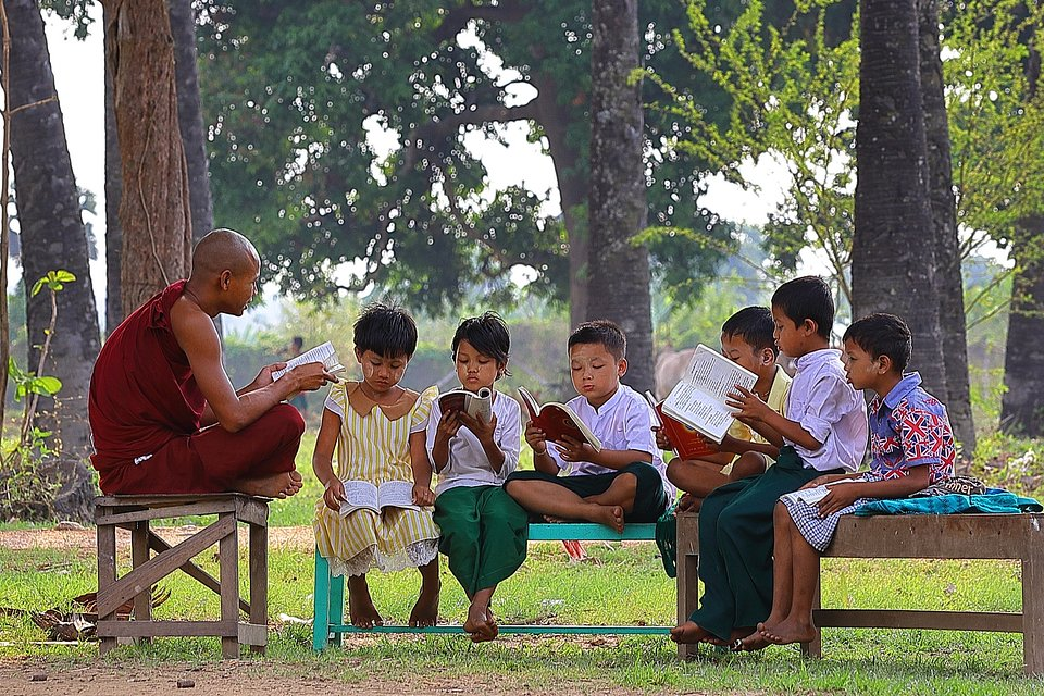 A group of students being taught a lesson in a park in Myanmar. (Ye Kyaw Thu/Agora)