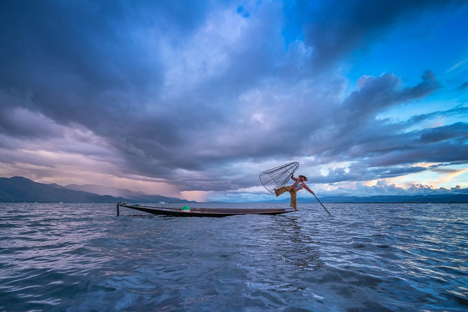 All of the vivid colors of the sunrise are captured in this perfect shot. The fisherman's stance will leave you on the edge of your seat. (Phyo Thein Kha/Agora)