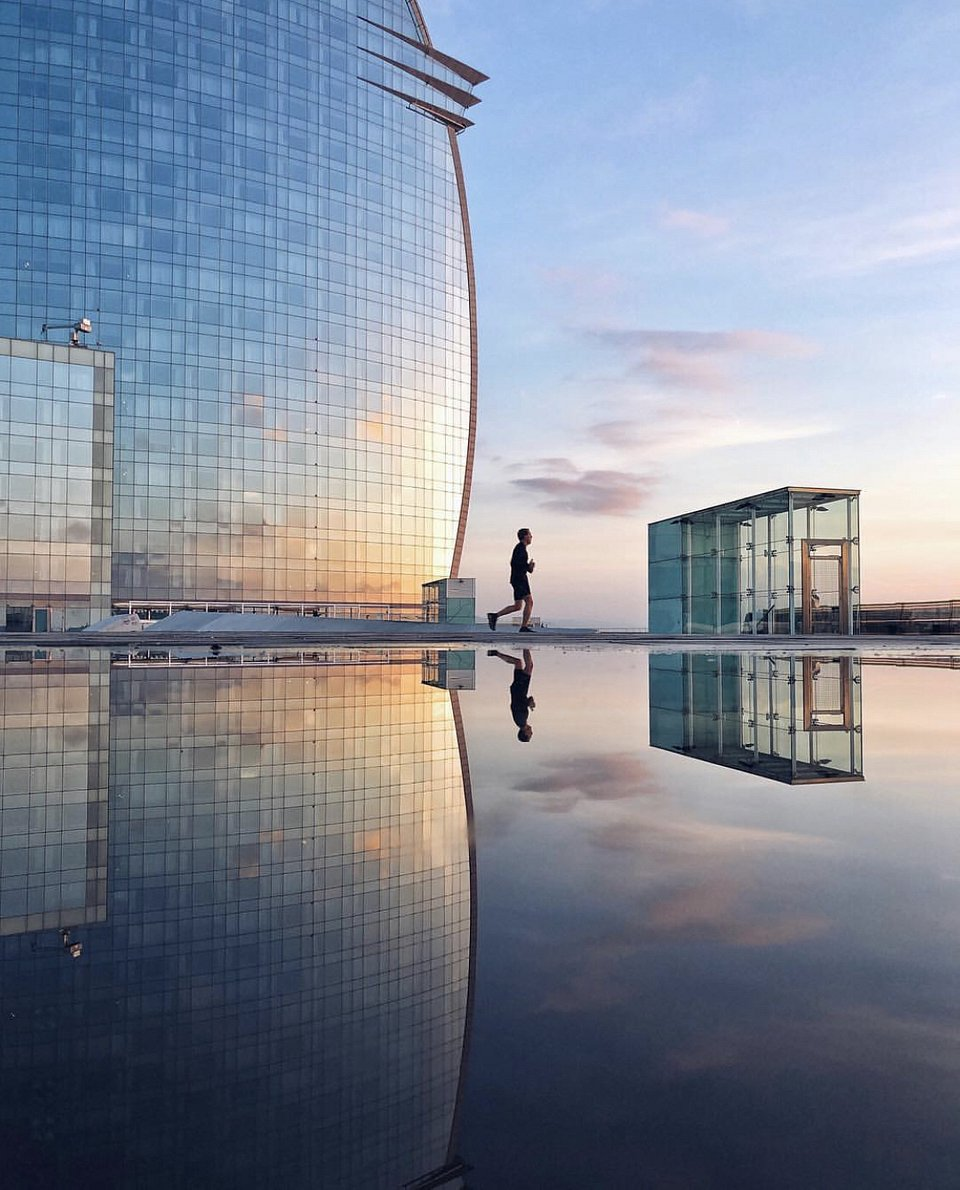 A perfect morning reflection was captured here on a run in Barcelona, Spain. (Albert Castañe/Agora)
